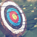 Archery target and arrows. Abstract concept: hit goals and focus on success. Vintage style.